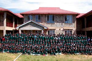 Students from BCFC Christian Academy pose for a photo outside their new school building in Kapenguria, Kenya, East Africa