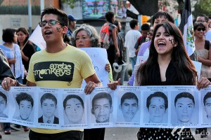 Protestors march in the streets of Mexico City after 43 students were abducted by police and allegedly executed. © Gatifoto, Flickr.