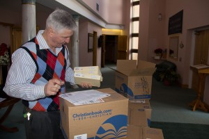 Dr. Larry Saunders inventories a book order for the Free Presbyterian Christian Bookstore in Littleton London, Jamaica.