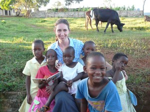 Ulster Mission Joanne Greer picture with school children in Uganda, East Africa.